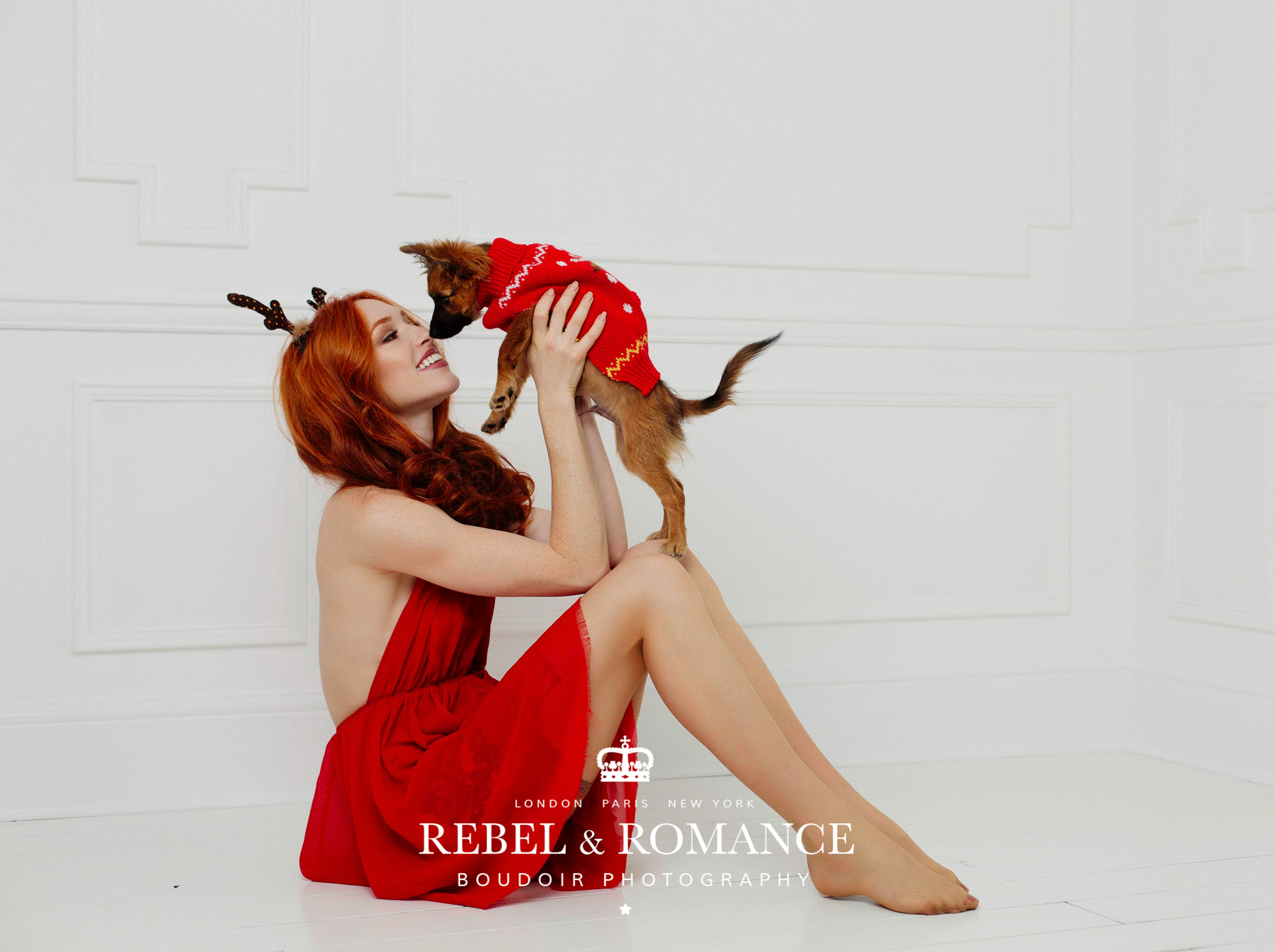 Kat and puppy Ralf in red for a Christmas inspired boudoir session.