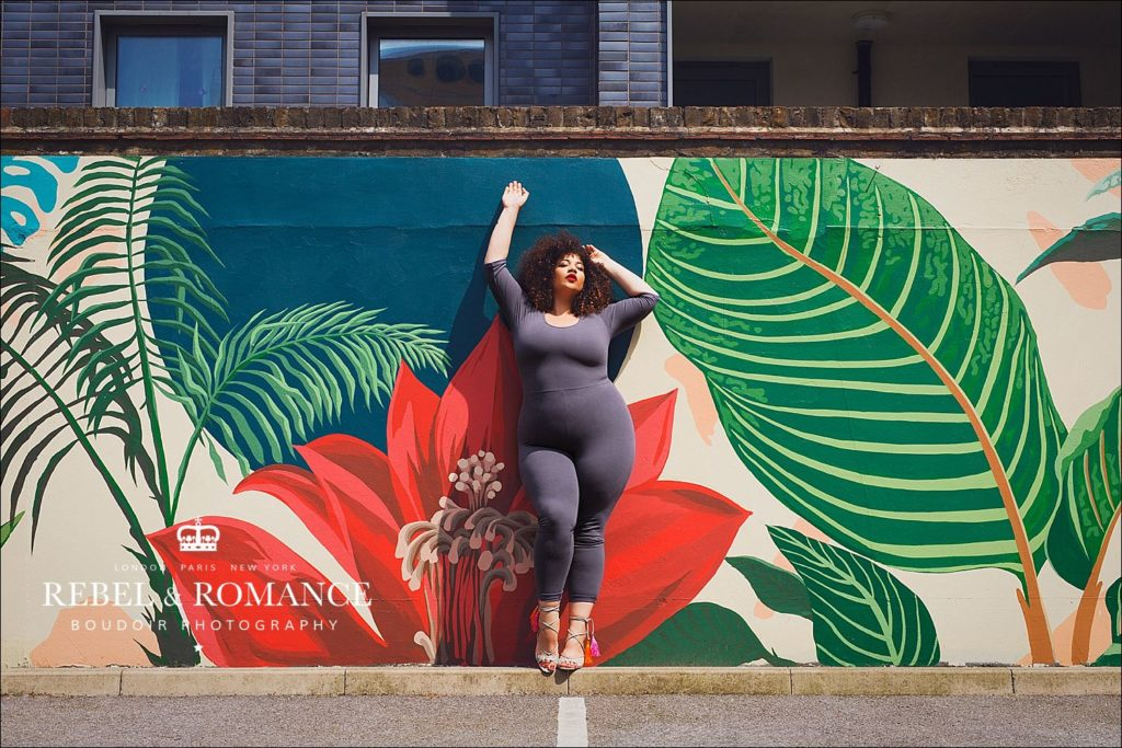 plus size model in front of tropical wall mural by Hicks & Hicks