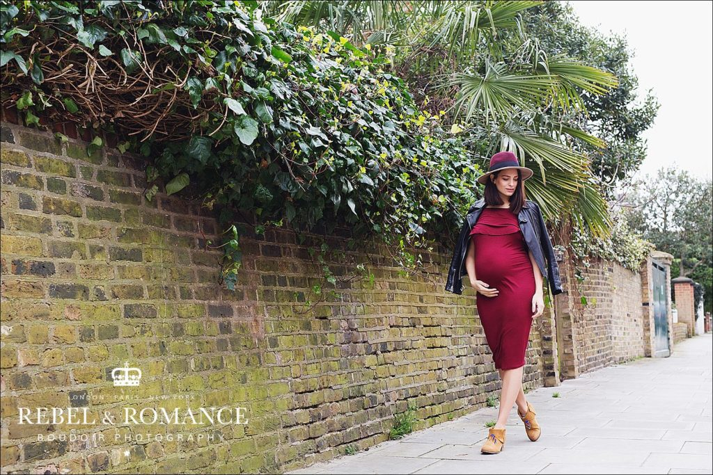pregnant woman in red dress in london